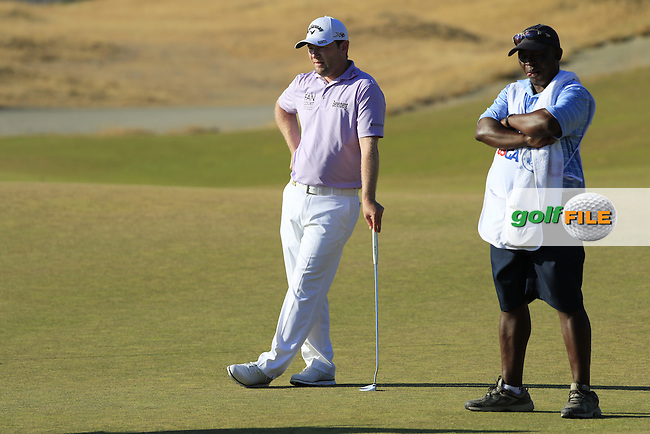 Branden GRACE (RSA) and caddy Zack Rasego on the 16th green during Sunday's Final Round of the 2015 U.S. Open 115th National Championship held at Chambers Bay, Seattle, Washington, USA. 6/22/2015.<br /> Picture: Golffile | Eoin Clarke<br /> <br /> <br /> <br /> <br /> All photo usage must carry mandatory copyright credit (&copy; Golffile | Eoin Clarke)