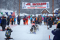 Anna Stephan leaves the start of the 2018 Junior Iditarod Sled Dog Race on Knik Lake in Southcentral, Alaska.  Saturday February 24, 2018<br /> <br /> Photo by Jeff Schultz/SchultzPhoto.com  (C) 2018  ALL RIGHTS RESERVED