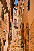 Narrow stairs leading through ancient residential section of Toledo, Spain