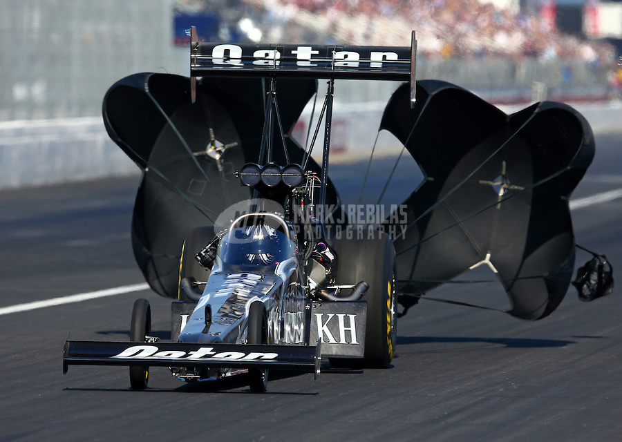 Feb 8, 2014; Pomona, CA, USA; NHRA top fuel dragster driver Shawn Langdon during qualifying for the Winternationals at Auto Club Raceway at Pomona. Mandatory Credit: Mark J. Rebilas-