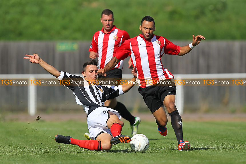 Chris Bourne of AFC Hornchurch is tackled by Lea Dawson (L) of East Thurrock - AFC Hornchurch vs East Thurrock United - Ryman League Premier Division Football on Non-League Day at The Stadium, Upminster Bridge, Essex - 07/09/13 - MANDATORY CREDIT: Gavin Ellis/TGSPHOTO - Self billing applies where appropriate - 0845 094 6026 - contact@tgsphoto.co.uk - NO UNPAID USE