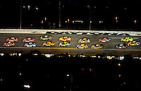 Feb 07, 2009; Daytona Beach, FL, USA; NASCAR Sprint Cup Series drivers race through turn three during the Bud Shootout at Daytona International Speedway. Mandatory Credit: Mark J. Rebilas-