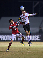 Patrick Mullins (15) of Maryland goes up for a header with Buck Tufty (10) of Louisville during the game at Ludwig Field in College Park, MD.  Maryland defeated Louisville, 3-1.