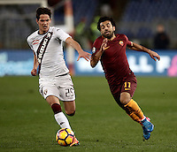 Calcio, Serie A: Roma, stadio Olimpico, 19 febbraio 2017.<br /> Roma&rsquo;s Mohamed Salah (l) in action with Torino's Sasa Lukic (r) during the Italian Serie A football match between As Roma and Torino at Rome's Olympic stadium, on February 19, 2017.<br /> UPDATE IMAGES PRESS/Isabella Bonotto