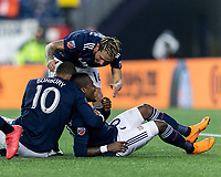 Foxborough, Massachusetts - May 12, 2018: First half action. In a Major League Soccer (MLS) match, New England Revolution (blue/white) vs Toronto FC (red), at Gillette Stadium.<br /> Cristian Penilla celebrates his goal with teammates.