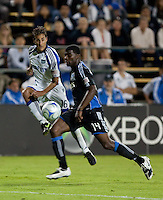 Josh Wolff (16) kicks the ball against Brandon McDonald (14). The San Jose Earthquakes defeated the Kansas City Wizards in stoppage time 1-0 at Buck Shaw Stadium in Santa Clara, California on August 22, 2009.
