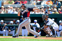 Atlanta Braves second baseman Dan Uggla #26 at bat in front of catcher Alex Avila #13 during a Spring Training game against the Detroit Tigers at Joker Marchant Stadium on February 27, 2013 in Lakeland, Florida.  Atlanta defeated Detroit 5-3.  (Mike Janes/Four Seam Images)