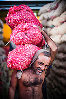 Man carrying vegetables at Dambulla vegetable and produce market in Dambulla, Central Province, Sri Lanka, Asia. This is a photo of a man carrying vegetables at Dambulla vegetable and produce market, Dambulla, Central Province, Sri Lanka, Asia.