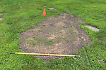 A rake is seen on the grounds beside a freshly buried grave at the Burr Oak Cemetery, one of the oldest and most historic black American cemeteries on the outskirts of Cook County, the same day four cemetery managers and caretakers were arrested on felony charges of disinterring and dismembering bodies at the cemetery in order to resell the plots to unsuspecting members of the public in Alsip, Illinois on July 9, 2009.