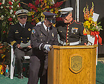 September 20, 2004 Angels Camp, California --Tuolumne Fire –-  Fallen firefighter Eva Marie Schicke's fiance CDF firefighter Shea Buhleris and brother Marine Sgt. John Schicke share memories with the three thousand in attendance at her memorial service held at the Calaveras County Fairgrounds. The Tuolumne Fire was a small very fast-moving fire that started around noon on September 12, 2004 near Lumsden Bridge at the bottom of the Tuolumne River.  The fire moved rapidly up the 80-plus-degree slope catching Cal Fire Helitack firefighters, tragically killing firefighter Eva Marie Schicke and injuring five others.