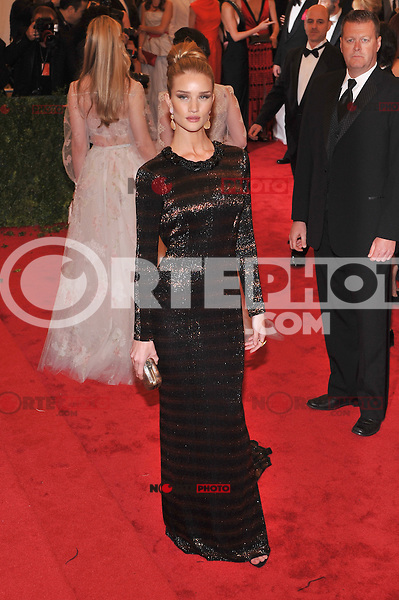 Rosie Huntington-Whiteley at the 'Schiaparelli And Prada: Impossible Conversations' Costume Institute Gala at the Metropolitan Museum of Art on May 7, 2012 in New York City. ©mpi03/MediaPunch Inc.
