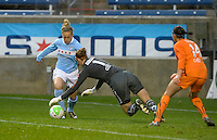 Chicago forward Ella Masar (3) attempts to allude diving Sky Blue goalkeeper Karen Bardsley (1) while Brittany Talyor (14) guards the goal.  Sky Blue FC defeated the Chicago Red Stars 1-0 at Toyota Park in Bridgeview, IL on April 25, 2010.