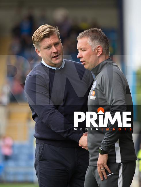Oxford United manager Karl Robinson shakes hands with Peterborough United manager Darren Ferguson during the Sky Bet League 1 match between Oxford United and Peterborough at the Kassam Stadium, Oxford, England on 10 August 2019. Photo by Andy Rowland.