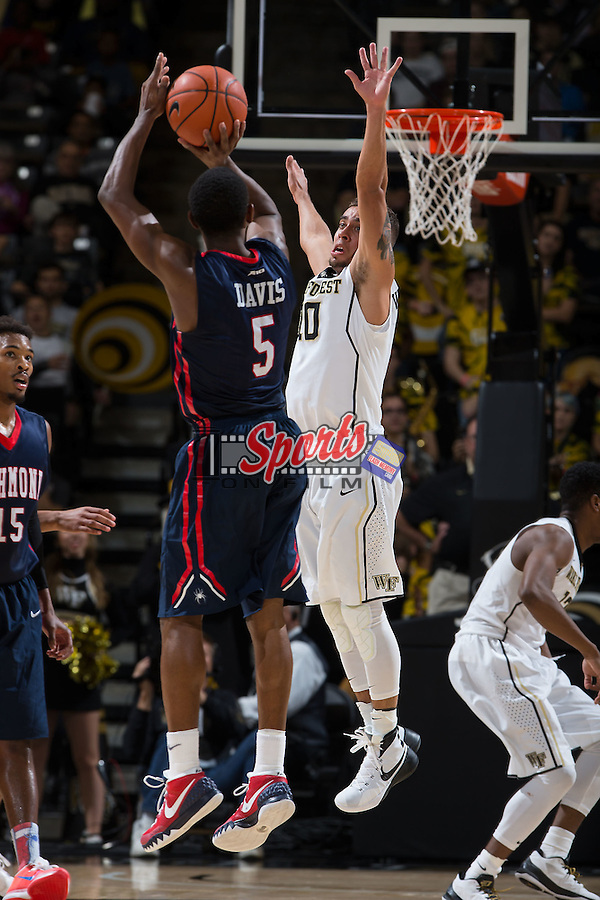 Mitchell Wilbekin (10) of the Wake Forest Demon Deacons attempts to block the shot of Trey Davis (5) of the Richmond Spiders during second half action at the LJVM Coliseum on November 18, 2015 in Winston-Salem, North Carolina.  The Spiders defeated the Demon Deacons 91-82.  (Brian Westerholt/Sports On Film)