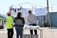LOS ANGELES - APR 11:  Masks for sale table in empty parking lot at the Businesses reacting to COVID-19 at the Hospitality Lane on April 11, 2020 in San Bernardino, CA