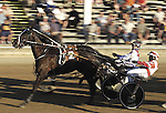"The #2 horse ""Whataterrificfella"" , foreground,  driven by Todd Warren, finishes just ahead of ""Teriffic McGoozer"", driven by Rick Ray in race number 5 Tuesday night at the Ottawa County Fair..(7/23/02)"