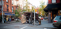 United Parcel Service couriers prepare a delivery on Bleecker Street in the West Village neighborhood of New York on Friday, November 9, 2012. (© Richard B. Levine)