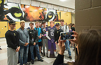 NWA Democrat-Gazette/BEN GOFF @NWABENGOFF<br /> Friends pose with Donte Jones, Bentonville football player, after he signed his national letter of intent to play at Central Arkansas Wednesday, Feb. 6, 2019, during a signing ceremony at Bentonville's Tiger Arena.