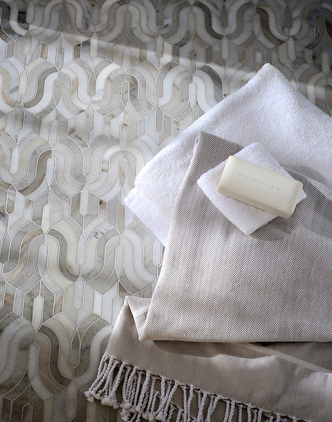 Kasbah, a handmade mosaic from New Ravenna, is shown in honed Angora and Cashmere.<br />
