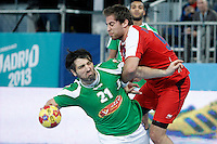 Algeria's Mohamed Aski Mokrani (l) and Egypt's Mohamed Hisham during 23rd Men's Handball World Championship preliminary round match.January 15,2013. (ALTERPHOTOS/Acero) /NortePhoto