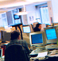 Busy clutterd open office setting with computers.