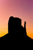 A silhouette of The Mittens table mountains at sunset in Monument Valley National Park and navaho Indian reservation,  Utah, USA