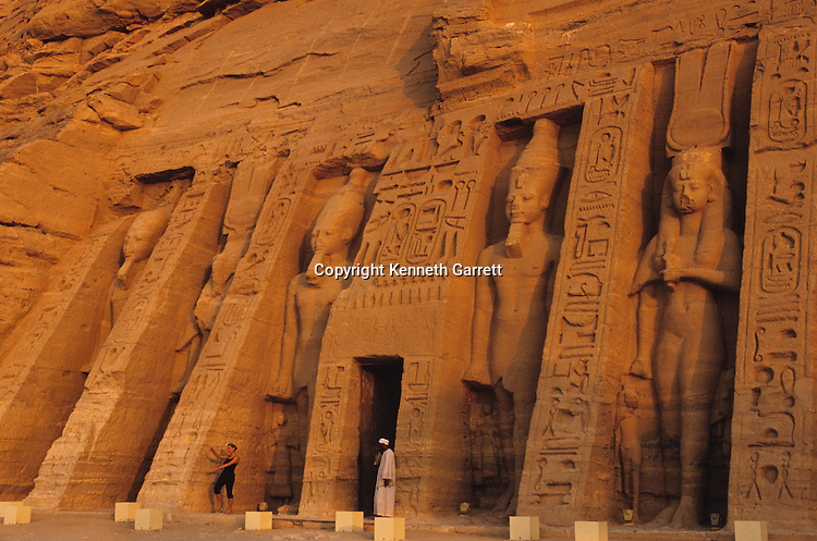 Colossal statues of Ramses II and Nefertari on the exterior of Nefertari's temple at Abu Simbel, Egypt