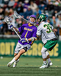 6 April 2019:  University at Albany Great Dane Attacker Tehoka Nanticoke, a Sophomore from Six Nations, Ontario, is checked by University of Vermont Catamount Defender Chris Cote, a Freshman from Mont-Royal, Québec, at Virtue Field in Burlington, Vermont. The Cats rallied to defeat the Danes 10-9 in America East divisional play. Mandatory Credit: Ed Wolfstein Photo *** RAW (NEF) Image File Available ***