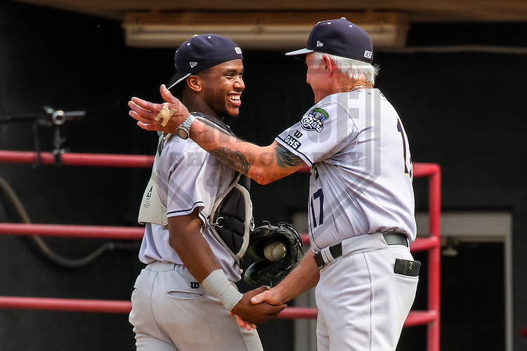 Kane County Cougars catcher Fernery Ozuna (9) and manager Butch Hobson (17) during a Midwest League game against the Wisconsin Timber Rattlers on June 11, 2017 at Fox Cities Stadium in Appleton, Wisconsin.  Kane County defeated Wisconsin 6-4. (Brad Krause/Krause Sports Photography)