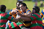 Daryl Sanft gets well wrapped up by Waiuku defenders Heinrich Fourie & Mark Muir. Counties Manukau Premier Club Rugby final between Patumahoe & Waiuku played at Bayers Growers Stadium Pukekohe on Saturday August 8th 2009. Patumahoe won 11 - 9 after leading 11 - 6 at halftime.
