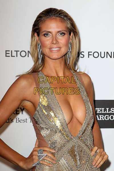 Heidi Klum (wearing Julien Macdonald).The 21st Annual Elton John AIDS Foundation Academy Awards Viewing Party held at The City of West Hollywood Park in West Hollywood, California, USA..February 24th, 2013.oscars half length gold diamante sequins sequined dress beads beaded art deco plunging neckline cleavage hands on hips rings .CAP/ADM/KB.©Kevan Brooks/AdMedia/Capital Pictures.