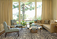 The living room's floor-to-ceiling picture window literally frames the outdoors creating natural life-size art