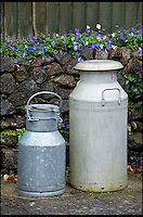 BNPS.co.uk (01202 558833)<br /> Pic: RachelAdams/BNPS<br /> <br /> Some of the milk churns Peter has collected. <br /> <br /> In a glass of his own...<br /> <br /> Dairy-daft Peter Hayward is udderly devoted to his bizarre hobby - collecting vintage milk bottles.<br /> <br /> The 70-year-old has devoted the last 30 years to building up a whopping collection of more than 1,000 bottles.<br /> <br /> Peter, a former dairy worker, scours the south west of Britain in search of rare bottles emblazened with the colourful logos of old dairies.<br /> <br /> And since retiring 16 years ago his collection has swelled so much that he has been forced to turn his garage into a mini museum.<br /> <br /> Peter's obsession with milk started as a 10-year-old when he helped his local milkman on his weekend rounds to earn some pocket money.<br /> <br /> He later joined Express Dairies as a distribution manager, working alongside hundreds of independent dairy farmers.<br /> <br /> When he retired in the late 1990s Peter had amassed a sizeable collection in his office - and decided to devote his free time to growing it.