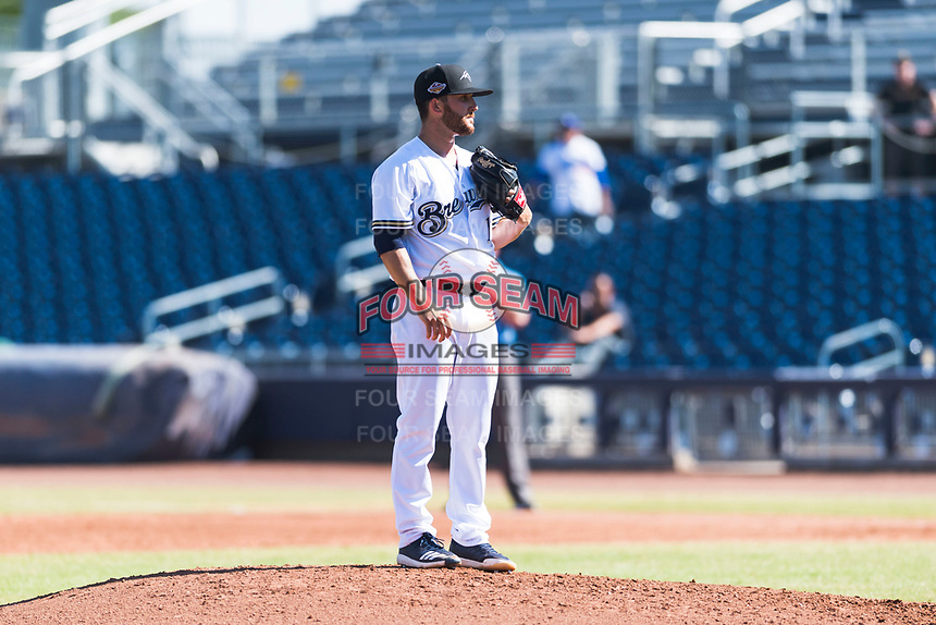Peoria Javelinas starting pitcher Bubba Derby (12), of the Milwaukee Brewers organization, looks in for the sign during an Arizona Fall League game against the Glendale Desert Dogs at Peoria Sports Complex on October 22, 2018 in Peoria, Arizona. Glendale defeated Peoria 6-2. (Zachary Lucy/Four Seam Images)