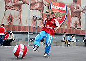 9th September 2017, Emirates Stadium, London, England; EPL Premier League Football, Arsenal versus Bournemouth; 4 year old Calum Brown wearing an Arsenal home shirt kicking an Arsenal ball outside Emirates Stadium before kick off