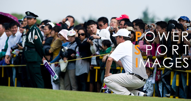 HAIKOU, CHINA - OCTOBER 30:  Hugh Grant of Great Britain lines up a putt on the 9th green during day four of the Mission Hills Start Trophy tournament at Mission Hills Resort on October 30, 2010 in Haikou, China. The Mission Hills Star Trophy is Asia's leading leisure liflestyle event and features Hollywood celebrities and international golf stars.  Photo by Victor Fraile / The Power of Sport Images