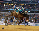 Taylor Price rides Show Stomper on his way to winning RFD TV's The American. Photo by Andy Watson