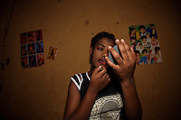 Asmar Maharate, 18, sex worker from Goldon, finishes to put her make up on in her private room before a long night at the bar where she works in Babile, Ethiopia on Wednesday Aug 16 20006..tens of young girls work in small bars in the boarder town of Babile, where the rat of HIV infections is among the highest in the country. they seel their bodies for less than 2 USD. None of these girls test for HIV and frequently are frequently forced into unprotected sex..Ethiopia is one of the countries most affected by HIV/AIDS. Of its population of 77 million, three million are HIV-positive, according to government statistics. Every day sees 1,000 new infections. A million children under 14 have lost one or both parents to AIDS, and 200,000 children are living with AIDS. That makes Ethiopia the country with the most HIV-positive children.