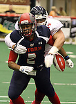 SIOUX FALLS, SD - MAY 16:  Chris Dixon #2 from the Sioux Falls Storm has the ball knocked from his hands by Torlan Pittman #99 form the Bemidji Axemen in the first half of their game Saturday night at the Sioux Falls Arena. (Photo by Dave Eggen/Inertia)