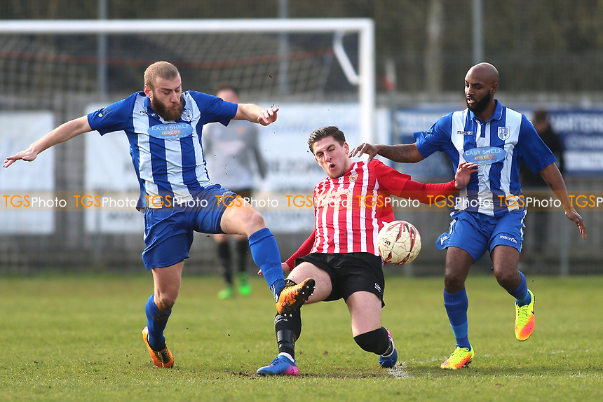 Jed Chouman of Hornchurch tangles with Bradley Woods-Garness (R) and Murat Karagul of Ware during Ware vs AFC Hornchurch, Ryman League Division 1 North Football at Wodson Park on 11th March 2017