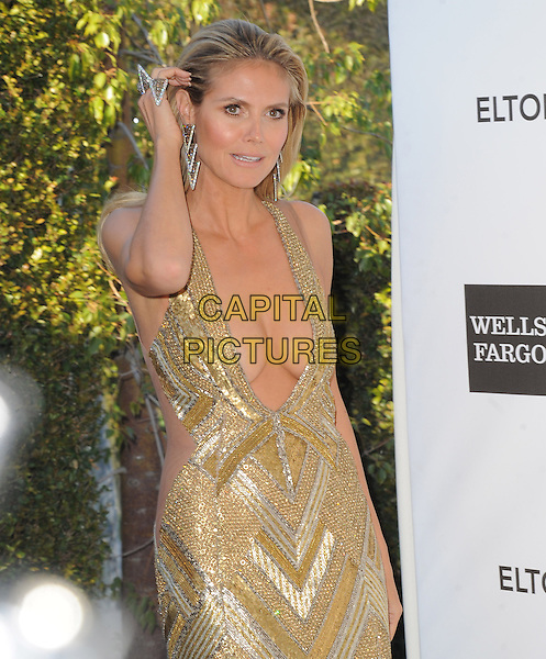 Heidi Klum (wearing Julien Macdonald).The 21st Annual Elton John AIDS Foundation Academy Awards Viewing Party held at The City of West Hollywood Park in West Hollywood, California, USA..February 24th, 2013.oscars half length gold diamante sequins sequined dress beads beaded art deco plunging neckline cleavage hand arm rings .CAP/DVS.©DVS/Capital Pictures.