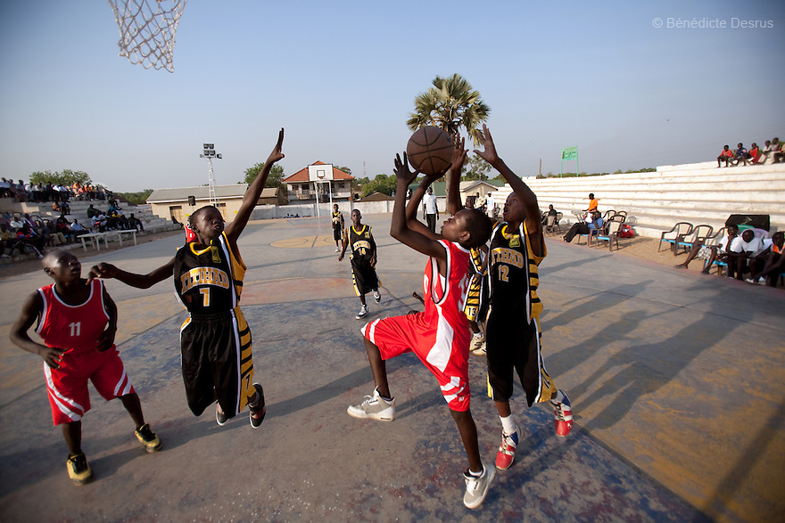 2011 - Juba, Sudan - Southern Sudanese basektball players compete in a local match in Juba basketball stadium in Nimra Talata, two days before the start of a landmark vote on independence after five decades of conflict between south and north of Sudan. If there is one thing south Sudan is famous for in the outside world, it is the super lofty stars with which it has studded the NBA and now, as nationhood beckons, it is basketball that it is looking to make a name in international sports. Photo credit: Benedicte Desrus