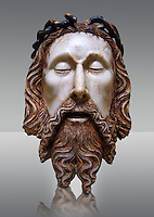Gothic wood statue of the Head of Christ by  Jaume Cascalls. Carved alabaster with polychrome and gilt remains.  This head must have belonged to a Recumbent Christ which could have formed part of a sculptural group of the Holy Sepulchre. It probably came from the chapel of Corpus Christi of the convent of Sant Agustí Vell, Barcelona.<br /> Jaume Cascalls is one of the most important sculptors of the fourteenth century in Catalonia. This is borne out by his involvement over almost thirty years with the project of the royal pantheon in Poblet for King Peter the Ceremonious and with other large undertakings of the time. Today, on stylistic grounds, he is credited with this 'Head of Christ', which must have formed part of a sculptural group of the Holy Sepulchre, presumably from the church of the convent of Sant Agustí Vell in Barcelona. The break in the neck suggests it belonged to a full-length recumbent Christ, like the one kept at Sant Feliu in Girona and also attributed to Cascalls. National Museum of Catalan Art, inv no: 034879-000