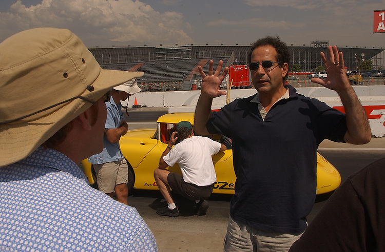 Experimental electric sports car T-Zero at the California Speedway in Fontana,  CA 3 September 2003.(Photo for The NYT/Gerard Burkhart)..-Writer Chris Dixon laughing giddily as he accerates to 100mph.-Talking to Actor Tony Shaloub ( check spelling!)....