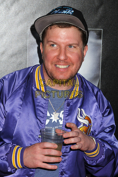 "Nick Swardson.""Waiting For Lightning"" Los Angeles Screening held at The Cinerama Dome, Hollywood, California, USA..April 10th, 2012.half length hands purple jacket baseball cap hat stubble facial hair.CAP/ADM/BP.©Byron Purvis/AdMedia/Capital Pictures."