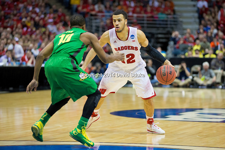 Wisconsin Badgers guard Traevon Jackson (12) handles the ball during the third-round game in the NCAA college basketball tournament against the Oregon Ducks Saturday, April 22, 2014 in Milwaukee. The Badgers won 85-77. (Photo by David Stluka)