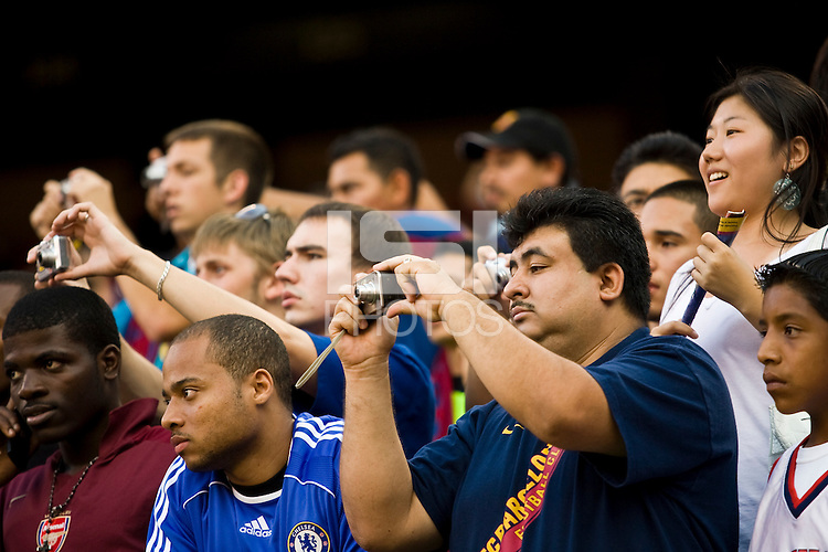 Fans take pictures of FC Barcelona players before the game. FC Barcelona defeated the New York Red Bulls 6-2 during an international friendly at Giants Stadium in East Rutherford, NJ, on August 6, 2008.