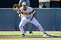 Michigan Wolverines first baseman Carmen Benedetti (43) records an out against the Central Michigan Chippewas on March 29, 2016 at Ray Fisher Stadium in Ann Arbor, Michigan. Michigan defeated Central Michigan 9-7. (Andrew Woolley/Four Seam Images)