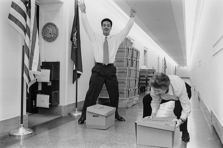 The staff of Rep. Leslie L. Byrne, D-Va., have gotten so good at assembling boxes that they have turned it into a competition (for our benefit) at the Longworth House Office Building, on Dec. 9, 1994. (Photo by CQ Roll Call via Getty Images)