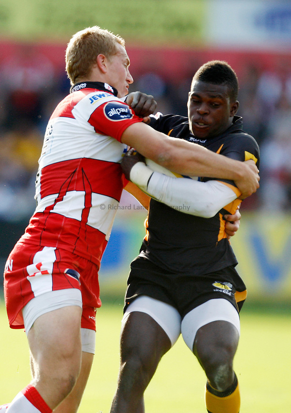 Photo: Richard Lane/Richard Lane Photography. Gloucester Rugby v London Wasps. Aviva Premiership. 22/09/2012. Wasps' Christian Wade is tackled by Gloucester's Billy Twelvetrees.